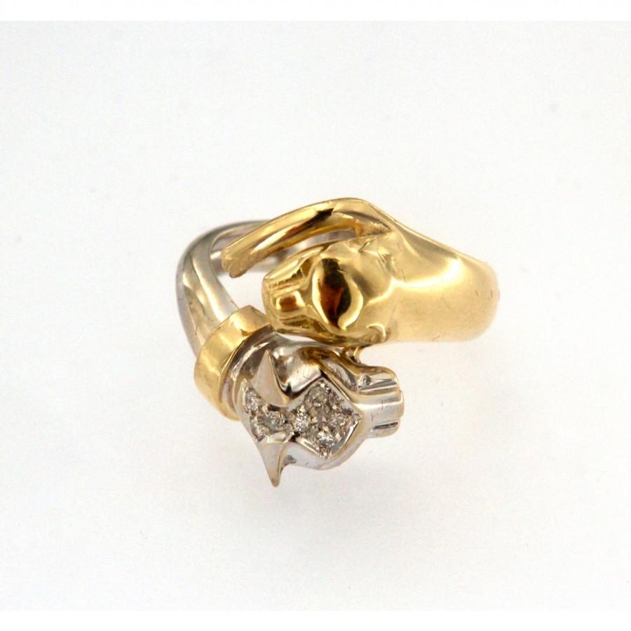 Anello bicolore in oro 18 kt. contrariè con 7 brillanti