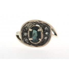 Anello in oro 12 kt e argento, in stile antico, con diamanti e uno zaffiro