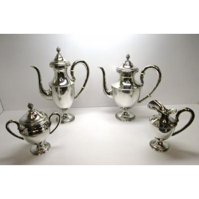 Quattro pezzi teiera lattiera caffettiera zuccheriera in argento 800 stile impero usati.