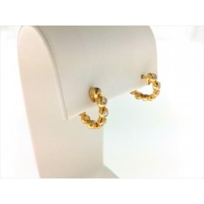Orecchini in oro giallo 18 Kt con diamanti 0,24. Peso 3,60 gr
