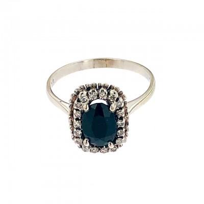 Anello in oro bianco 18 kt misura 19 con zaffiro blu sintetico  e diamanti anni 70 80 usato